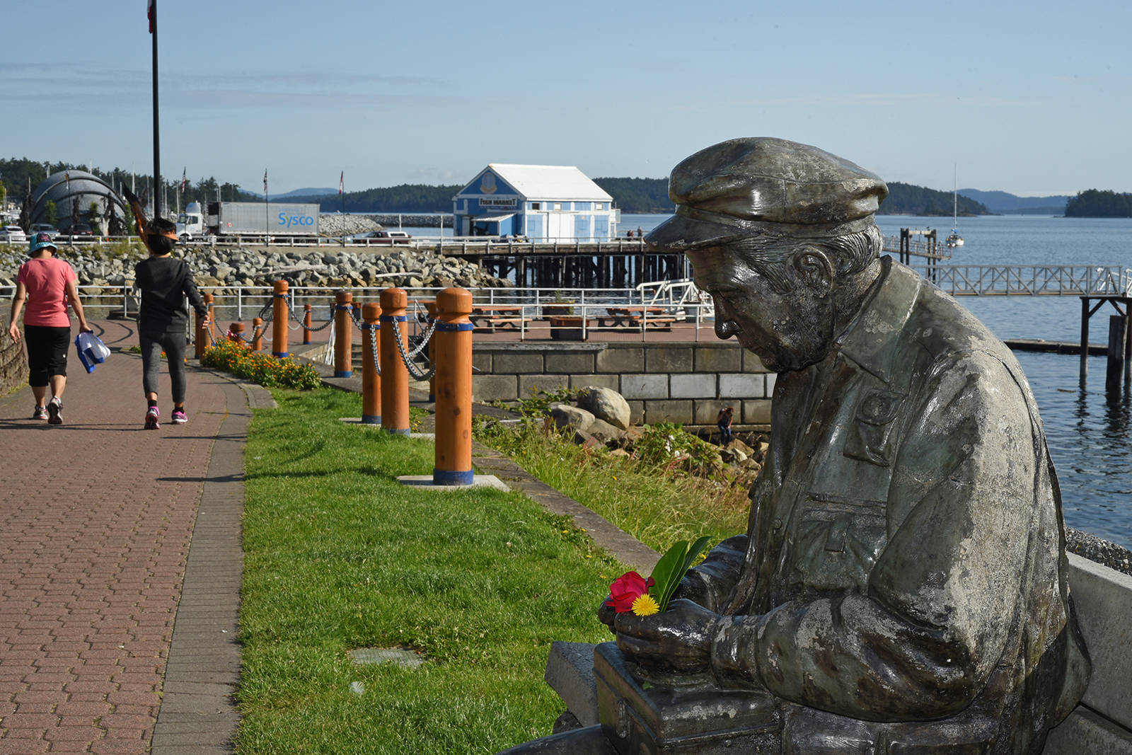 Nathan Scott's <em>Old Man of the Sea</em> sculpture sits along the Sidney waterfront. Don Denton photo